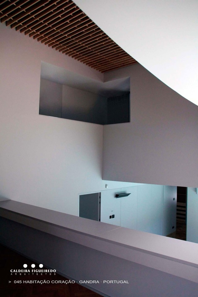two-wing-portuguese-house-with-concrete-look-wood-exterior-14-recessed-display.jpg