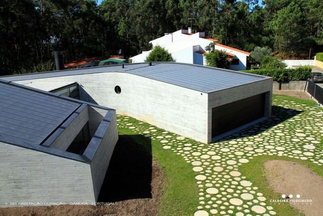 two-wing-portuguese-house-with-concrete-look-wood-exterior-5-short-side.jpg