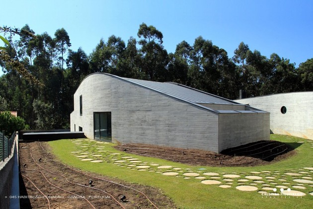 two-wing-portuguese-house-with-concrete-look-wood-exterior-6-sloping-profile.jpg