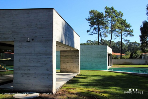 two-wing-portuguese-house-with-concrete-look-wood-exterior-7-pool-ends.jpg
