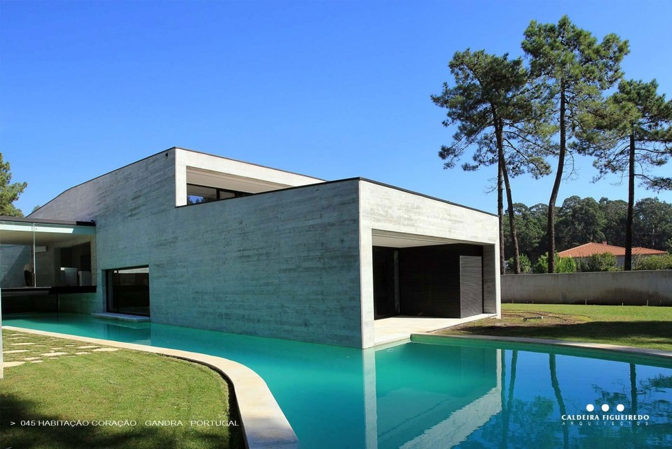 Concrete look home with wooden plank exterior for 2 story house with pool