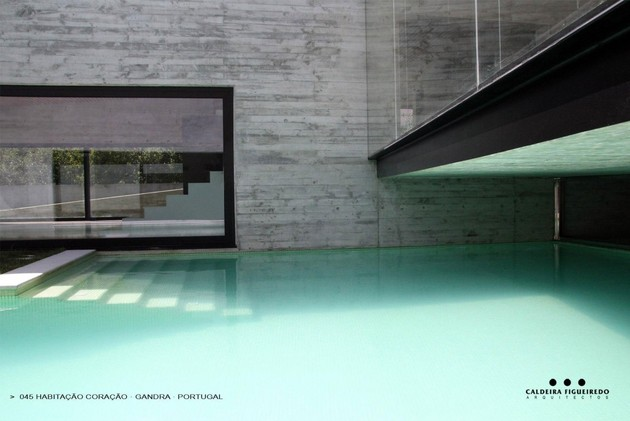 two-wing-portuguese-house-with-concrete-look-wood-exterior-9-pool-steps.jpg
