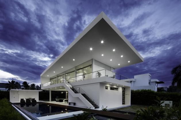 white home for two families with indoor outdoor downstairs 2 roof angle thumb 630x420 28385 Oversized Roof House Designed for Entertaining