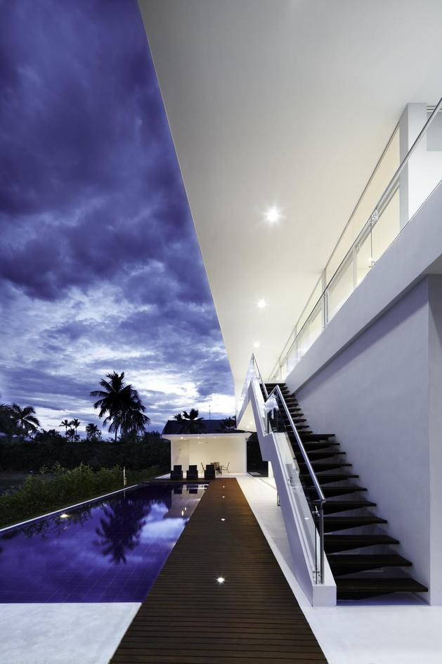 white-home-for-two-families-with-indoor-outdoor-downstairs-3-pool-path-stairway.jpg