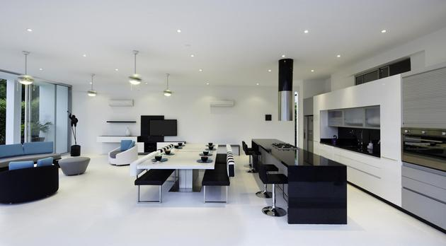 white-home-for-two-families-with-indoor-outdoor-downstairs-4-downstairs-living-space.jpg