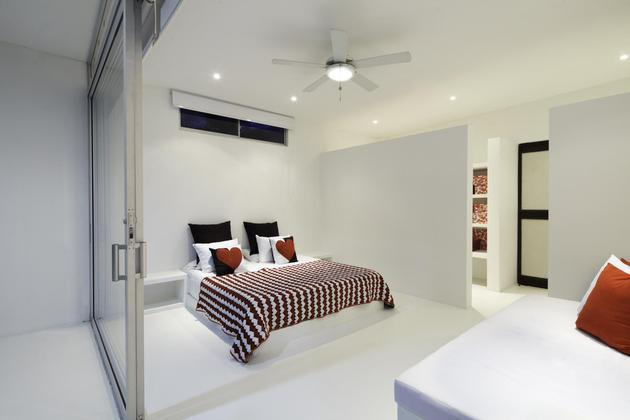 white-home-for-two-families-with-indoor-outdoor-downstairs-5-large-bedroom.jpg