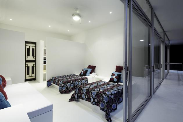 white-home-for-two-families-with-indoor-outdoor-downstairs-6-kids-room.jpg