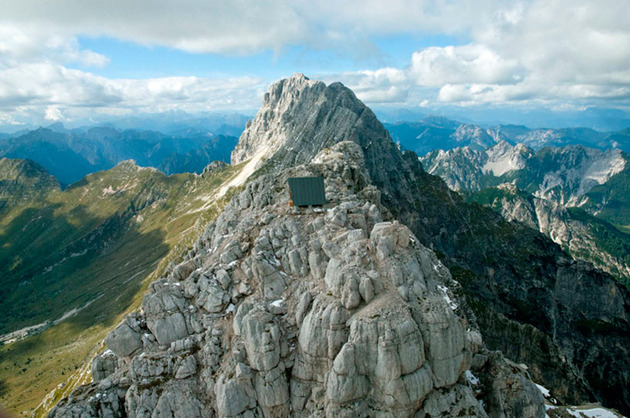 wooden-a-frame-hikers-rest-cabin-crowns-alpine-mountaintop-4-roof-elevation.jpg