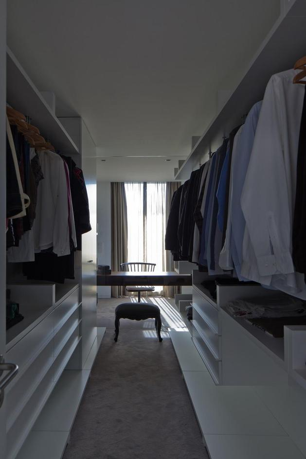 black-home-with-bright-interior-built-into-grassy-hillside-27-closet.jpg