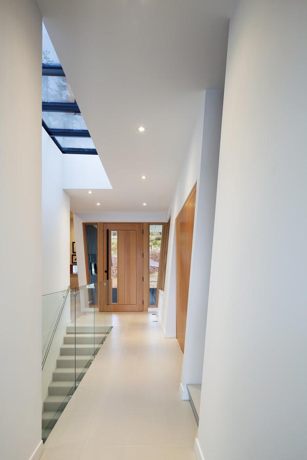 cantilevered-family-home-overlooks-lake-4-foyer.jpg