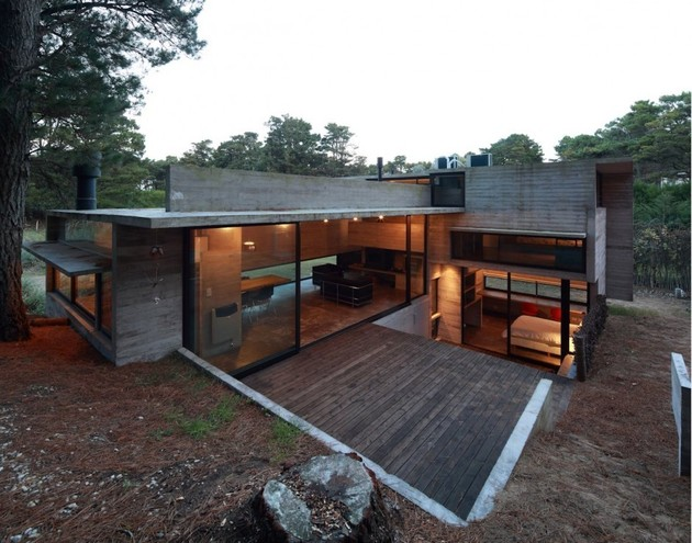 concrete steel home tucked pine forest 1 site thumb 630xauto 33458 Concrete and Steel Summer Home Tucked into Pine Forest
