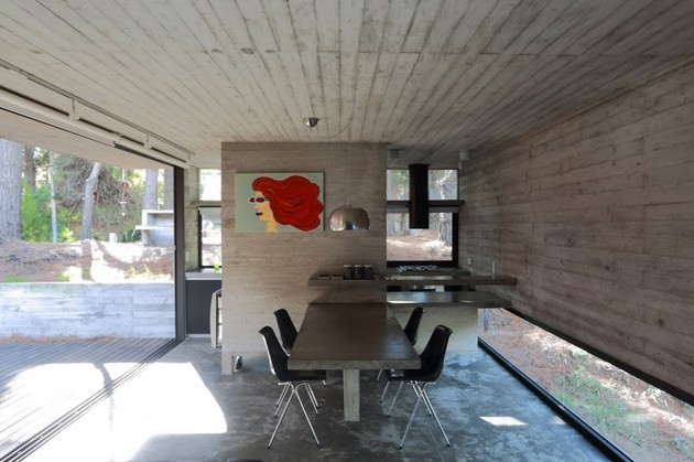 concrete-steel-home-tucked-pine-forest-10-dining.jpg