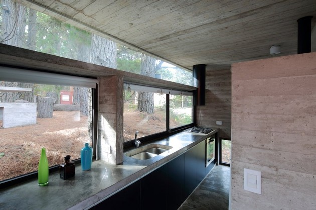 concrete-steel-home-tucked-pine-forest-12-kitchen.jpg