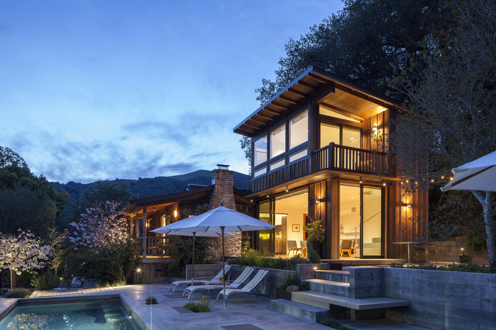 Cottage expansion uses local woods to compliment mountain for Mountain home design trends