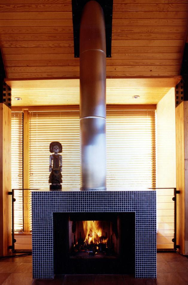 desert-dwelling-copper-clad-barrel-roof-23-fireplace.jpg