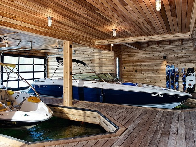 floating-wooden-one-bedroom-cabin-with-integrated-boathouse-10-boathouse.jpg