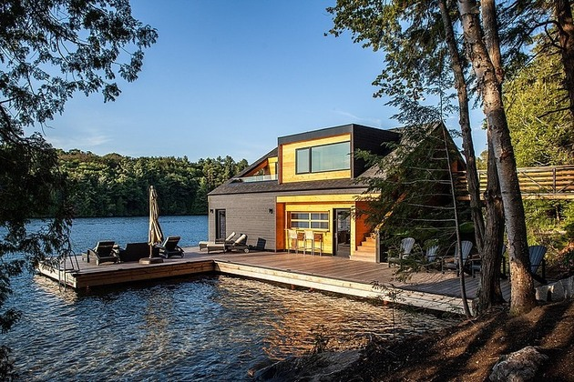 floating-wooden-one-bedroom-cabin-with-integrated-boathouse-3-deck-side.jpg