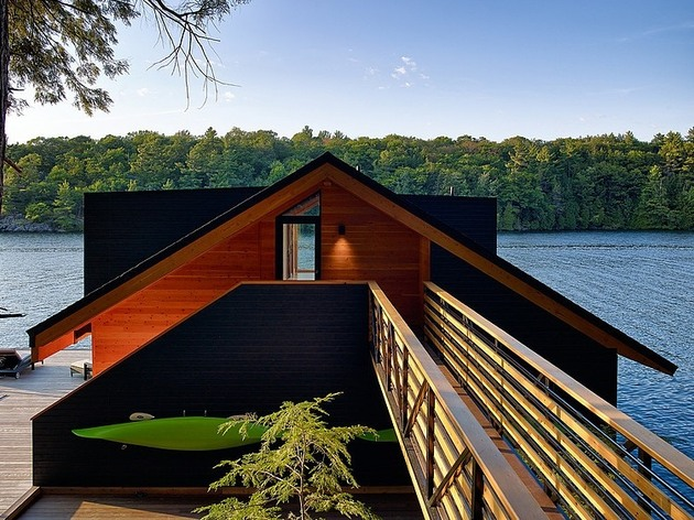 floating-wooden-one-bedroom-cabin-with-integrated-boathouse-5-entrance-bridge.jpg