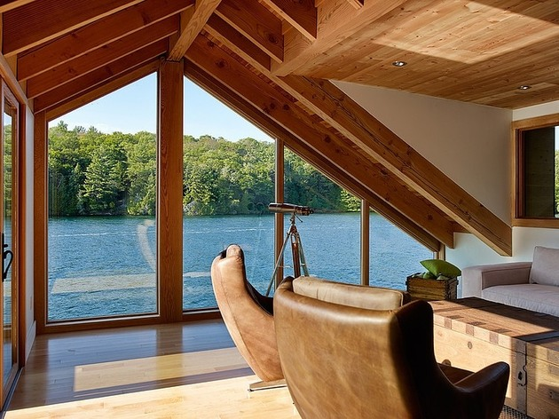 floating-wooden-one-bedroom-cabin-with-integrated-boathouse-7-living-room.jpg