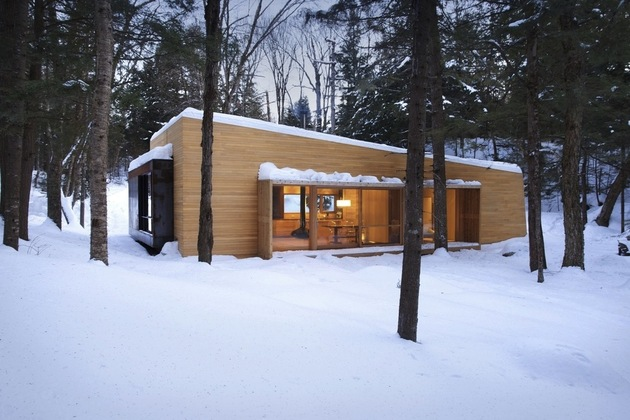 forest getaway cabin dominated by warm wood boards 1 roof slope thumb 630x420 30760 Forest Getaway Cabin with Sauna, Sunken Hot Tub