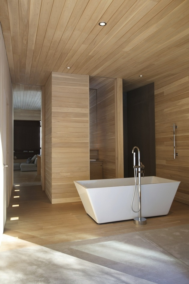 forest-getaway-cabin-dominated-by-warm-wood-boards-11-freestanding-tub.jpg