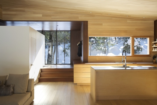 forest-getaway-cabin-dominated-by-warm-wood-boards-5-main-room.jpg