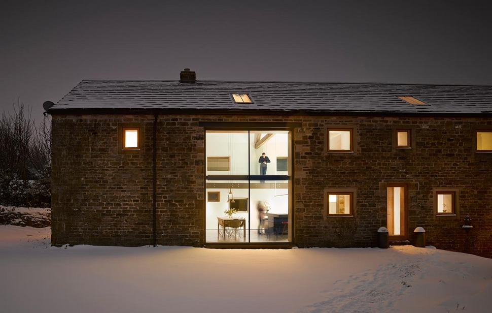 Historic Barn Reinvented Into Modern Home With Exposed Trusses