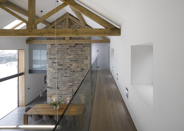 historic-barn-reinvented-modern-home-exposed-trusses-10-mezzanine.jpg