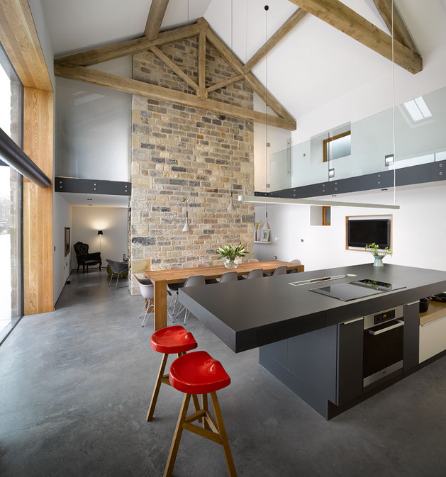 historic-barn-reinvented-modern-home-exposed-trusses-3-dining.jpg