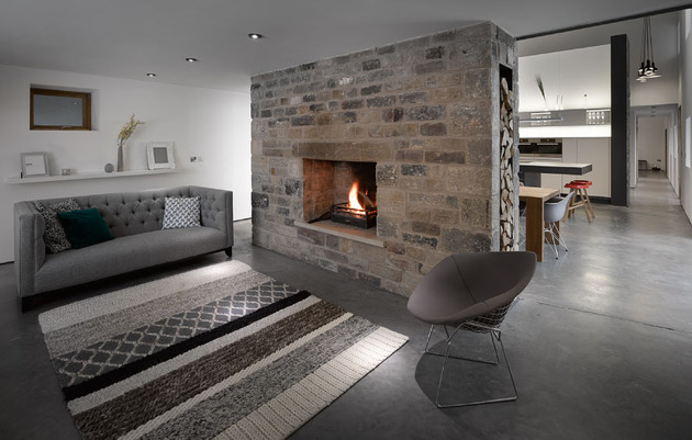 historic-barn-reinvented-modern-home-exposed-trusses-7-fireplace.jpg