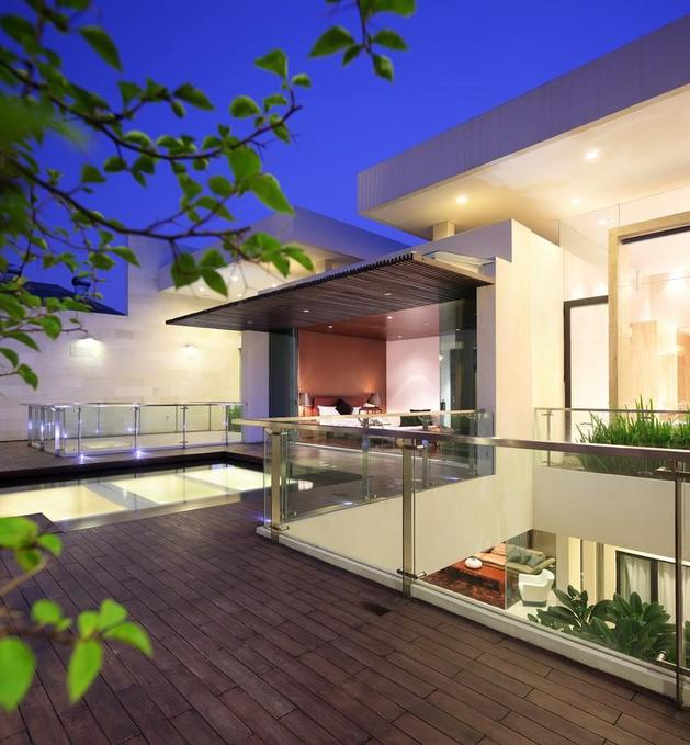 indonesian-zen-house-with-detailed-garden-filled-interior-25-master-angle.jpg