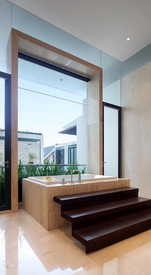 indonesian-zen-house-with-detailed-garden-filled-interior-30-tub-framed.jpg