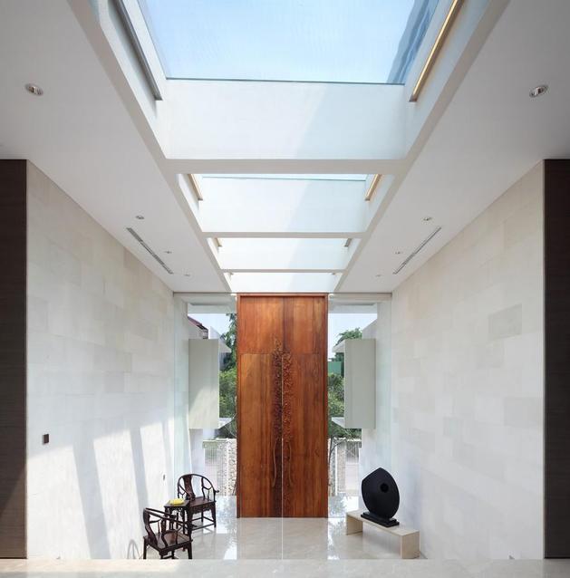 indonesian-zen-house-with-detailed-garden-filled-interior-7-front-door.jpg