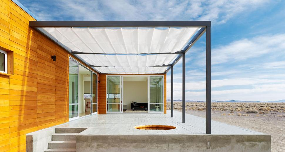 View In Gallery Isolated Desert Getaway House With Retractable Deck Cover