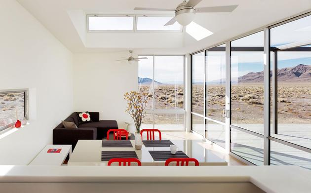 isolated-desert-getaway-house-with-retractable-deck-cover-6-living-room-kitchen.jpg