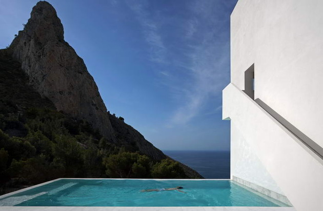 monolithic-house-suspended-above-the-sea-15.jpg