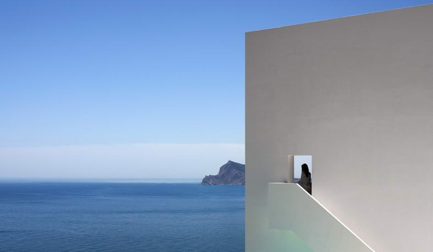 monolithic-house-suspended-above-the-sea-3.jpg