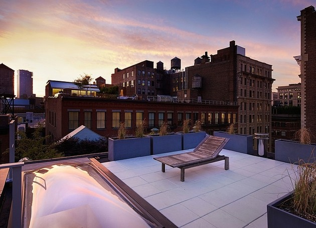 penthouse-apartment-two-hanging-fireplaces-10-rooftop-lounger.jpg