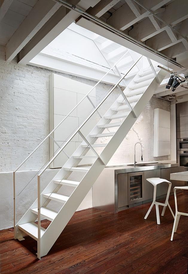 penthouse-apartment-two-hanging-fireplaces-3-steel-staircase.jpg