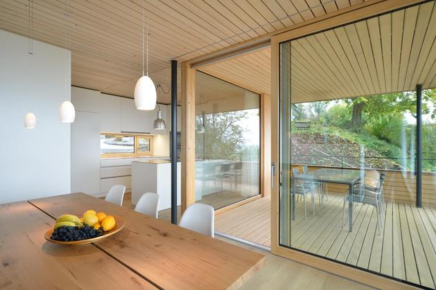 sustainable-geometric-house-rooftop-terrace-7-deck-dining.jpg
