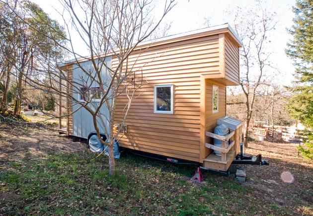 tiny-trailer-mounted-eco-friendly-traveling-home-3-side.jpg