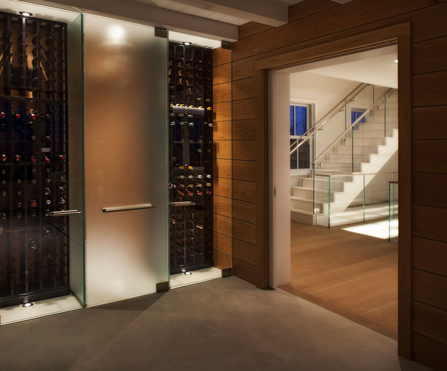 traditional-exterior-hides-colourfully-contemporary-interior-14-wine-cellar.jpg