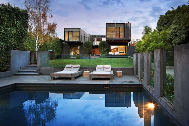 traditional facade hides thoroughly renovated contemporary residence 1 view from pool thumb 630x420 30431 Victorian style Facade Hides Super Modern Architecture