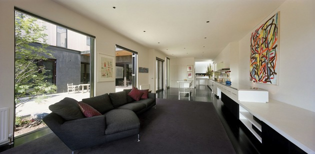 traditional-facade-hides-thoroughly-renovated-contemporary-residence-11-living-room-kitchen.jpg
