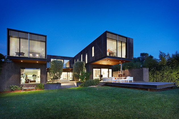 traditional-facade-hides-thoroughly-renovated-contemporary-residence-3-rear-angle-night.jpg