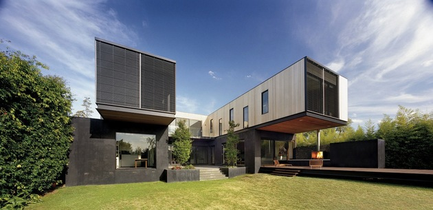 traditional-facade-hides-thoroughly-renovated-contemporary-residence-5-rear-angle-day.jpg