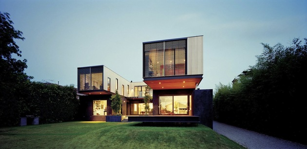 traditional-facade-hides-thoroughly-renovated-contemporary-residence-7-rear-lawn.jpg