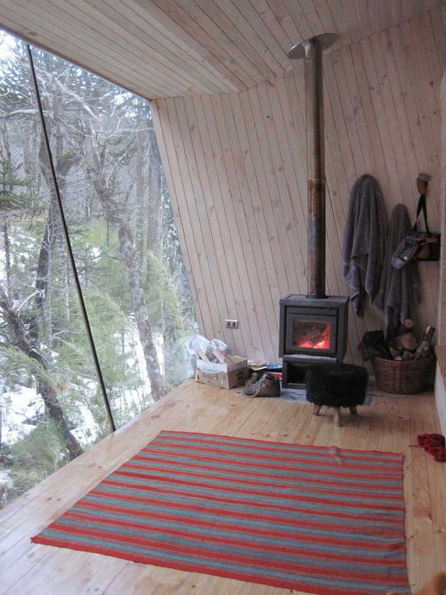winter-cabin-accessed-elevated-walkway-9-fireplace.jpg