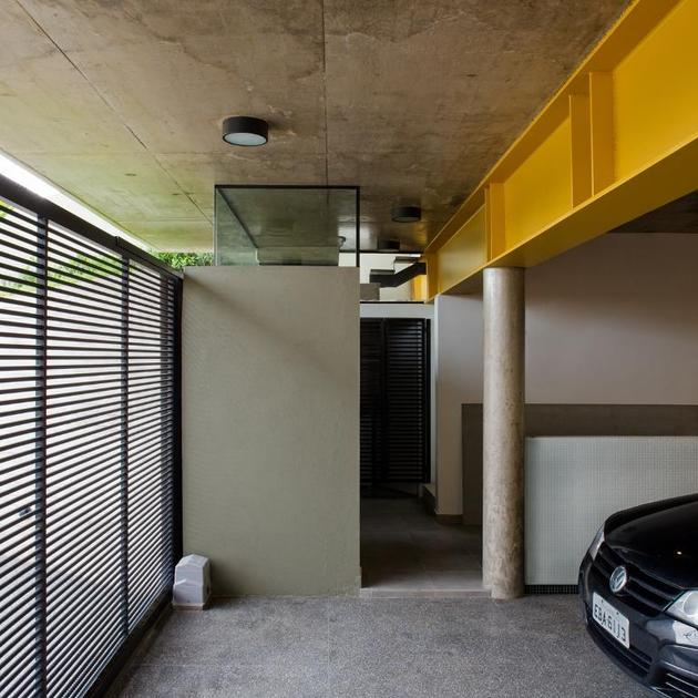concrete-cube-home-supported-2-yellow-i-beams-5-garage-interior.jpg