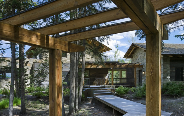 contemporary-stone-farmhouse-with-aged-wood-siding-segments-4-covered-path.jpg